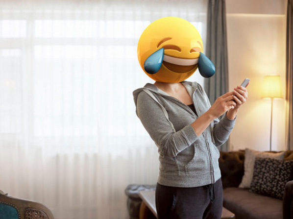 woman with cry laughing emoji head