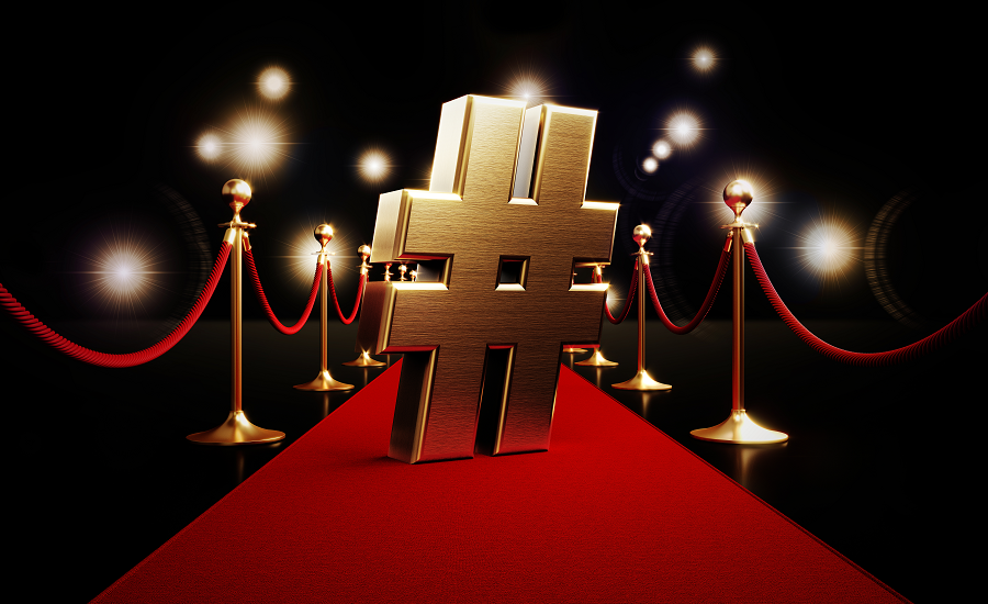 Red carpet with a gold hashtag