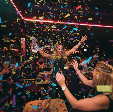 woman having fun at bonkers bingo party - Mecca Bingo