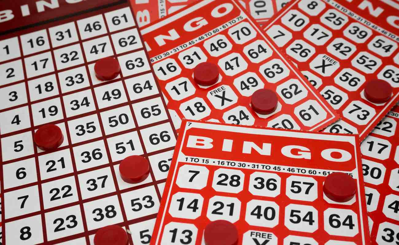 ultiple bingo cards with red counters scattered over them