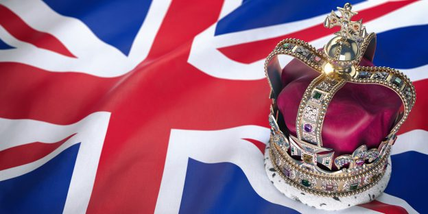 Royal golden crown with jewels on british flag. Symbols of UK United Kingdom.